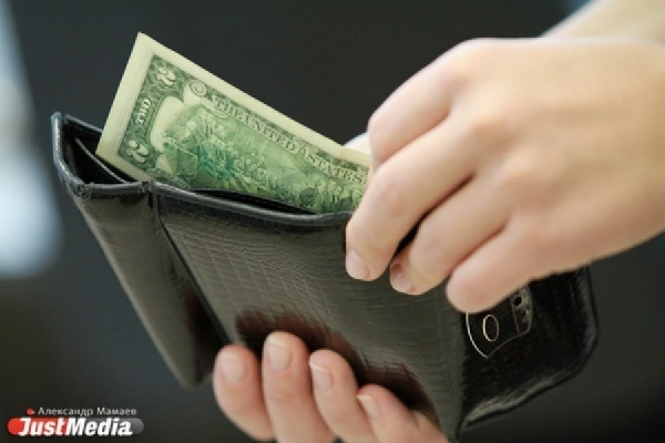 Эксперты: «Доллар не дает расти нефти и рублю»